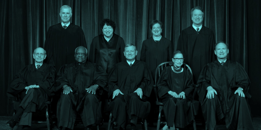 A photo of the nine Supreme Court Justices, in teal duotone